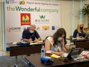 Two of our volunteers answering phones.